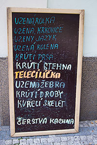 A sign in front of a Prague butcher shop